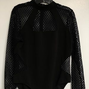 Long sleeve black bodysuit.